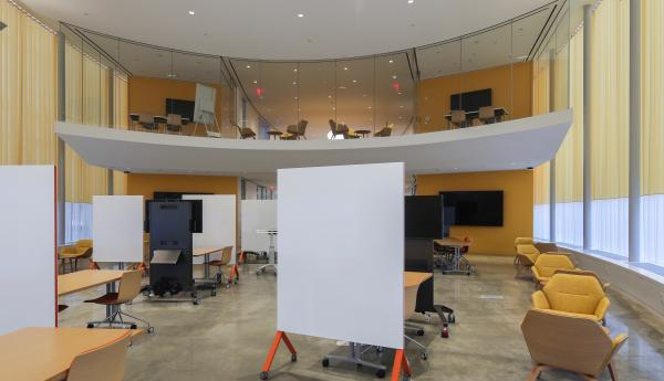 View of studio space with furniture and whiteboards