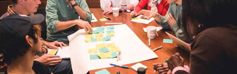 Students gathered around table with post-its
